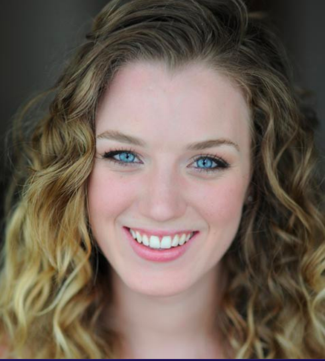 The Happie Courtney Colarik's head shot for dance with blue eyes and a big smile.
