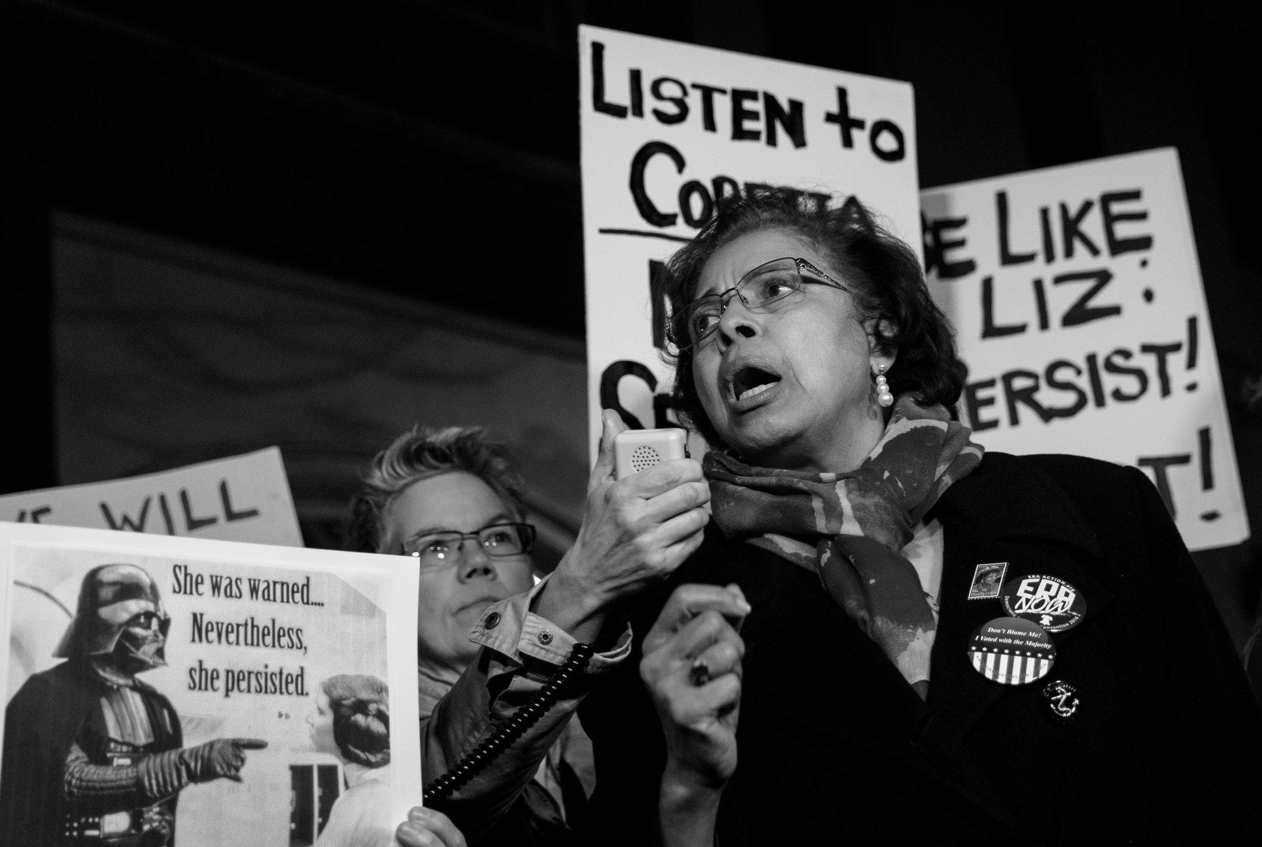 Dr. E. Faye Williams, National President/CEO of the National Congress of Black Women, reads from Coretta Scott King's letter outside Mitch McConnell's house on Capitol Hill
