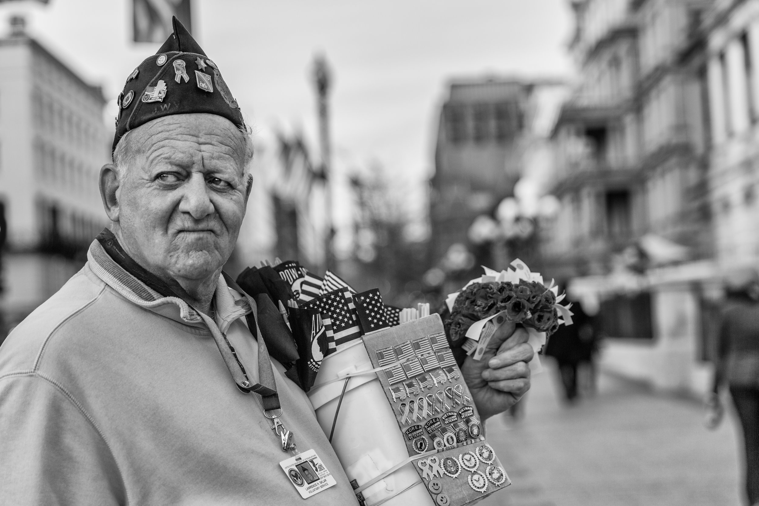 A Veteran sells pins & flags near the White House on the day before Donald Trump's Inauguration
