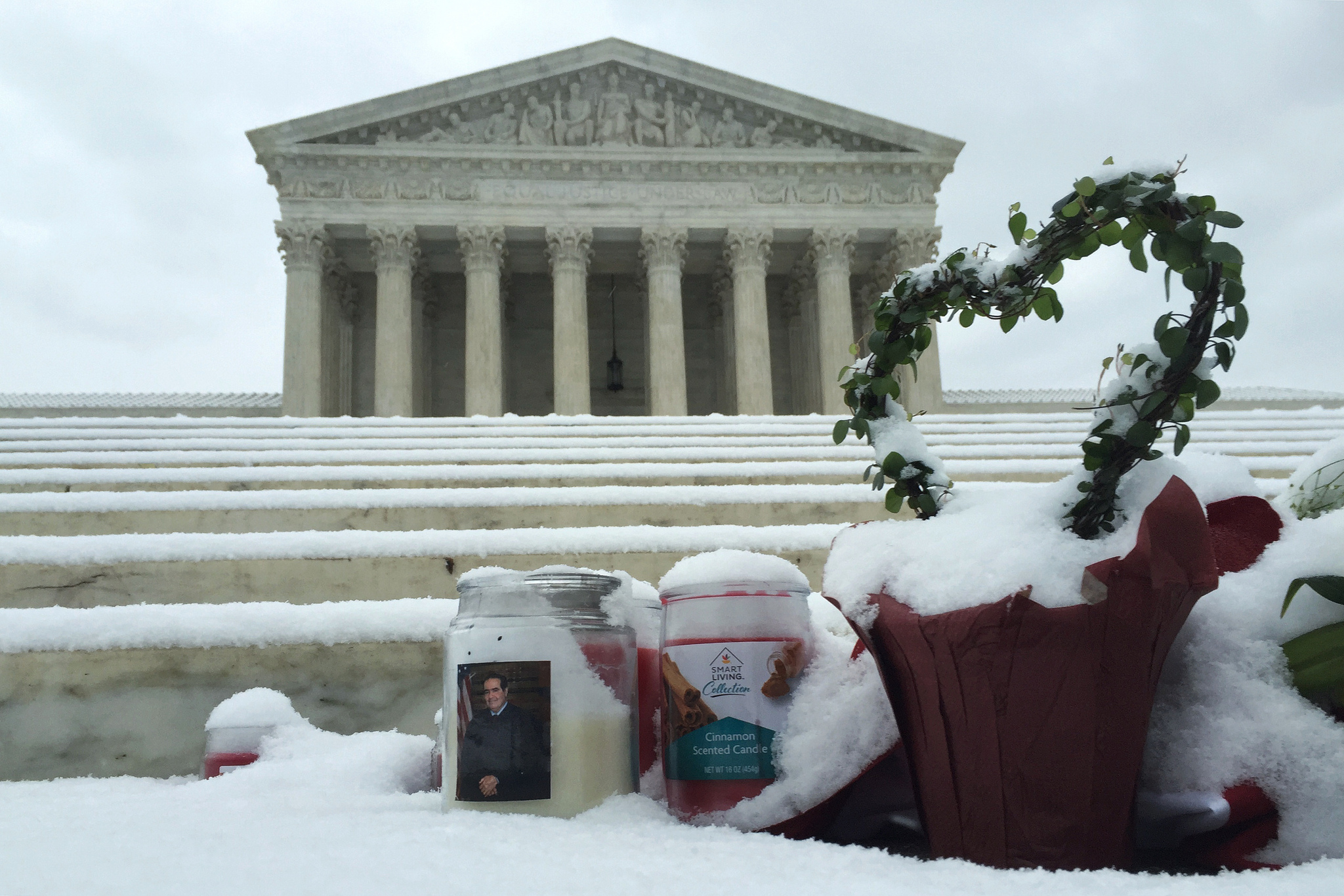 Snowy Scalia memorial with cinnamon scented candle