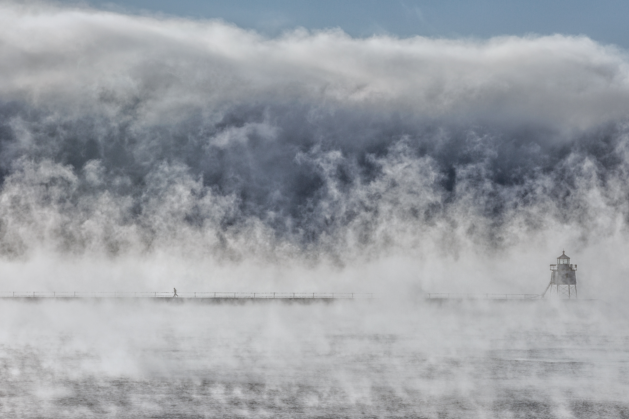 Sea smoke rises off the harbor and around the lighthouse at Two Harbors on a -15 degree morning.