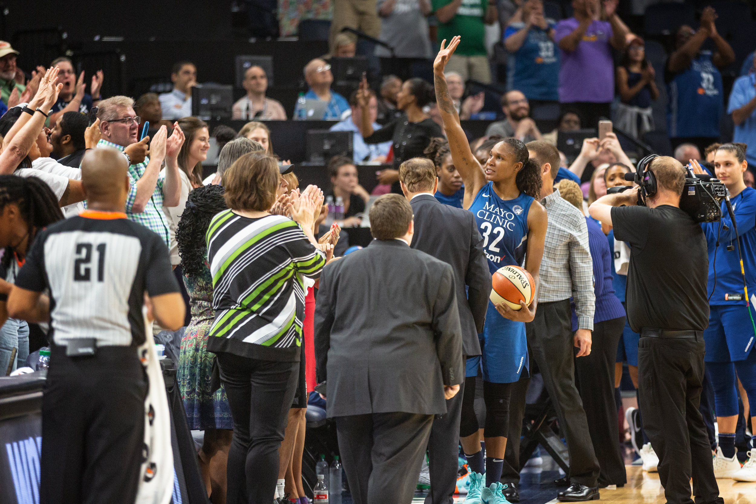 Rebekkah Brunson waves to the crowd at Target Center after breaking the all time WNBA rebound record