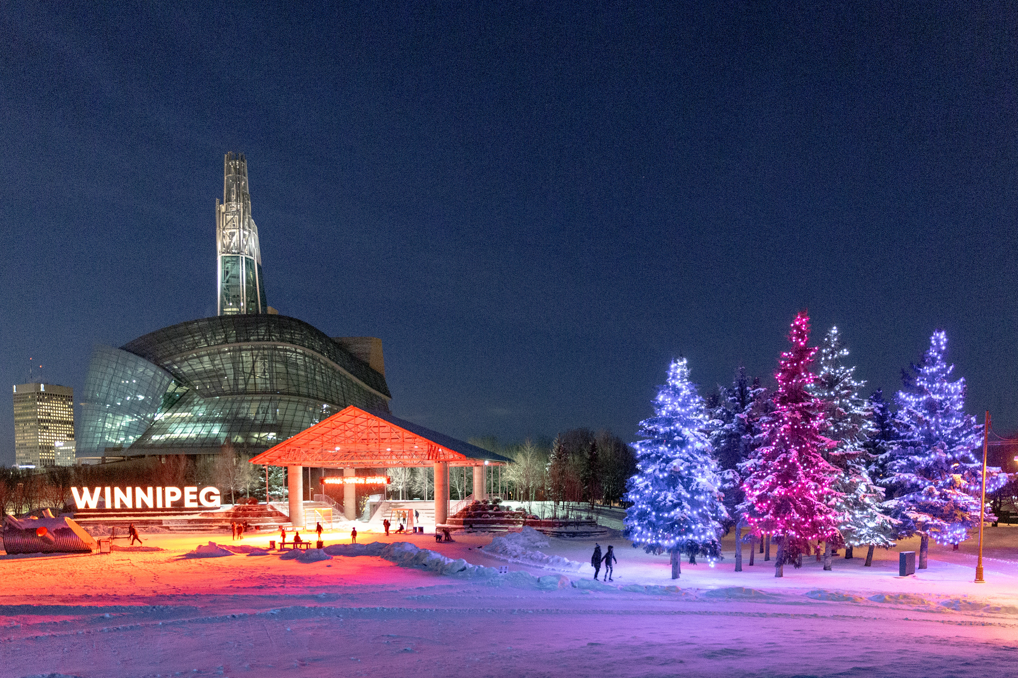 Skaters on the trail in the Arctic Glacier Winter Park at The Forks, Winnipeg Canada