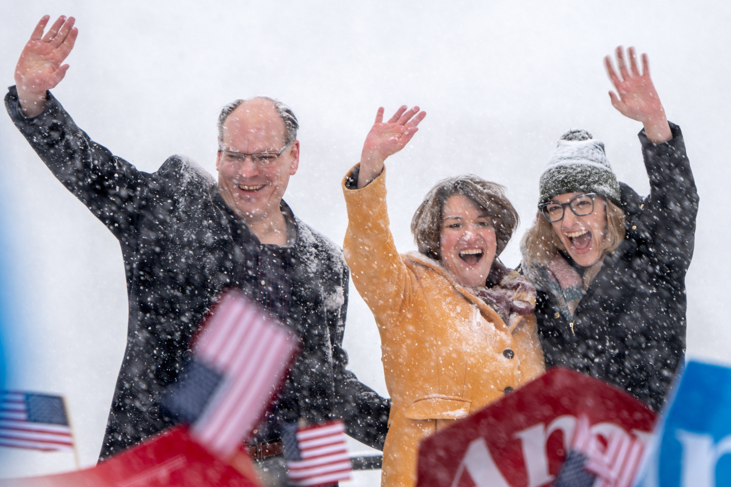 Amy Klobuchar with her husband John and daughter Abigail at her side, waves to the crowd after announcing her bid for the presidency at Boom Island Park in Minneapolis, Minnesota