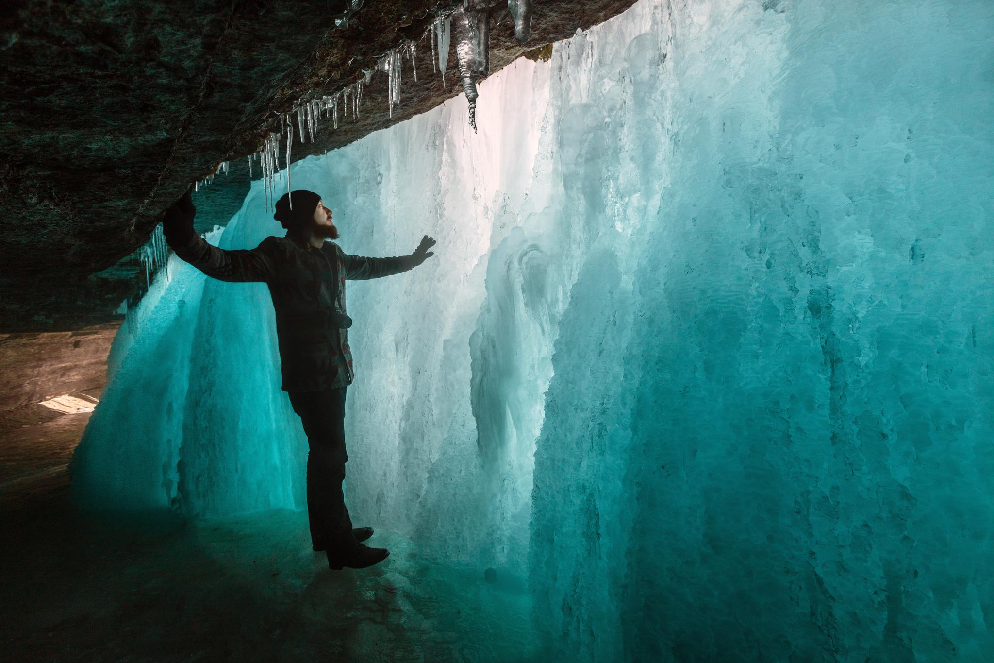 Exploring behind the falls. Minnehaha Falls frozen in winter, Minneapolis, Minnesota