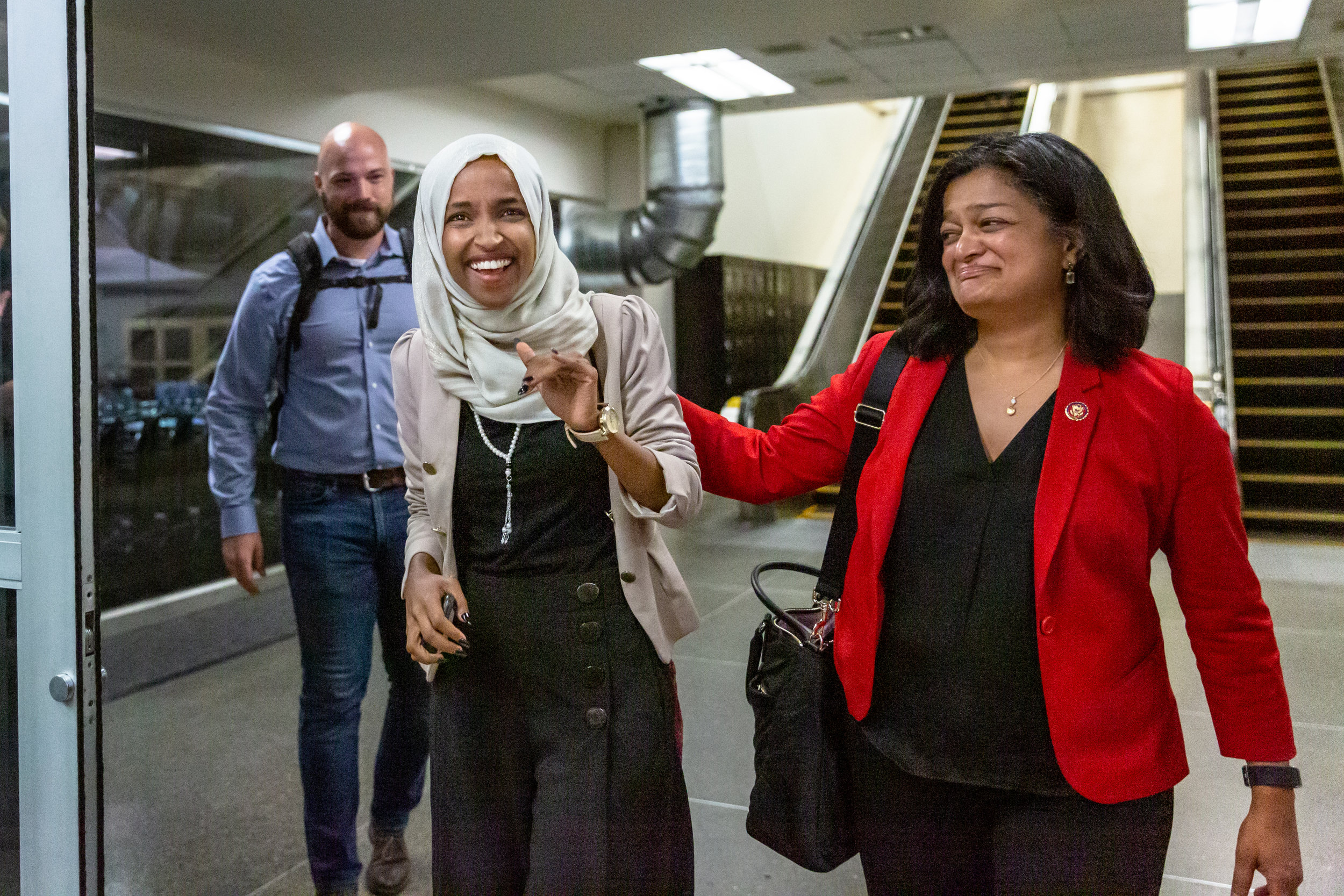 Representative Ilhan Omar reacts to supporters who came to welcome her home at MSP Airport.