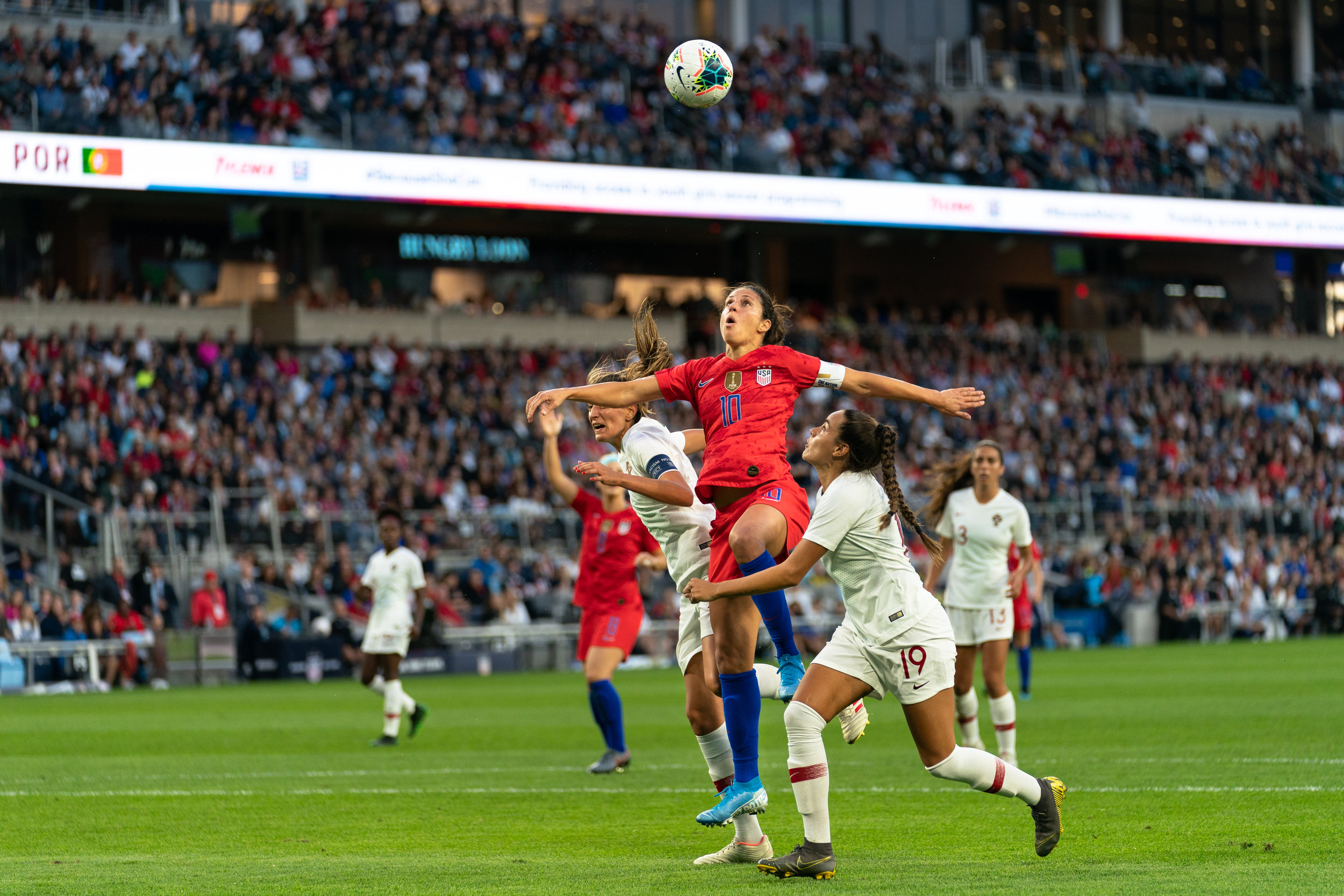 Carli Lloyd heads a ball in the USWNT's Victory Tour game against Portugal