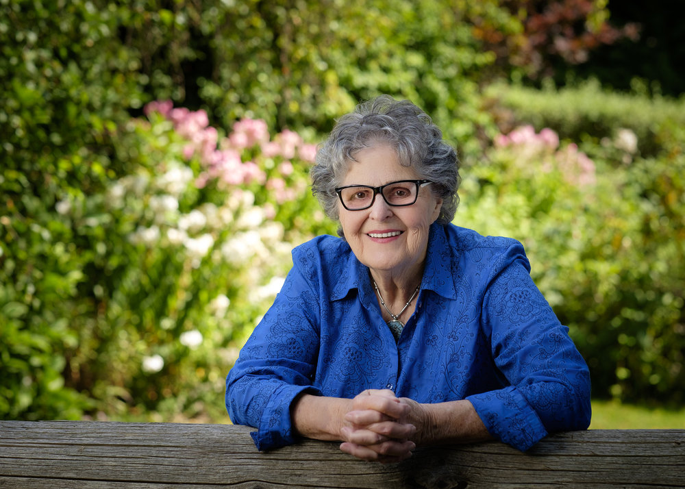 About Betty Annand - Betty Annand is the author of The Girl from Old Nichol and The Woman from Dover. Born in Vancouver, B.C., in 1927, she has resided in the Comox Valley on Vancouver Island since the age of ten. Widowed since 2002, she has enjoyed doing volunteer work at her church, the local hospital, and a local theatre, where she writes and directs plays for the seniors group. She resides in the house that she and her husband built sixty years ago and enjoys spending time with her family, who still live on the island. She is the author of three non-fiction books, Growing up in the White House, Voices from Bevan, and Voices from Courtenay Past.