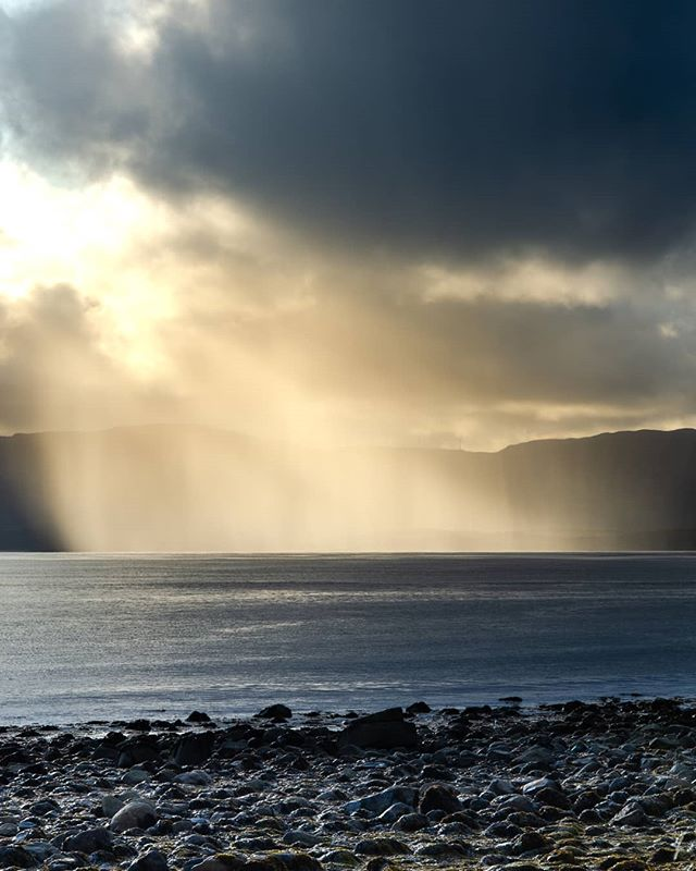 Another one from Arran. . We were driving on the coastal road one evening when I saw this amazing light. I pulled over into a lay-by and quickly set up the shot. . The conditions were so fleeting and changed compltely just a few seconds after I took this photograph as the sun wet behind a cloud and the rain came over the island. . One of those luck occasions being in the right place at the right time! . . . . . . #arran #livingthedream #landscapephotography #landscapes #seaview #seaside #seascape #rain #amazinglight #mountains #scotland #scottishweather #uk #travel #adventure #outdoorphotography #holiday #travelphotography #scottishisland #scottishislands
