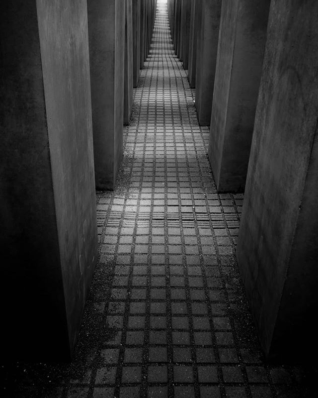 Walking through the holocaust memorial was an emotional experience that I'll never forget. . . . . . . . . #blackandwhite #monochrome #berlin #berlintourism #holocaustmemorial #holocaust #germany #europe #atmospheric #atmosphere #intothelight #explore #exploring #tourist #holiday #travelphotography #travel #seetheworld #outdoorphotography #brandenburggate #brandenburgtor