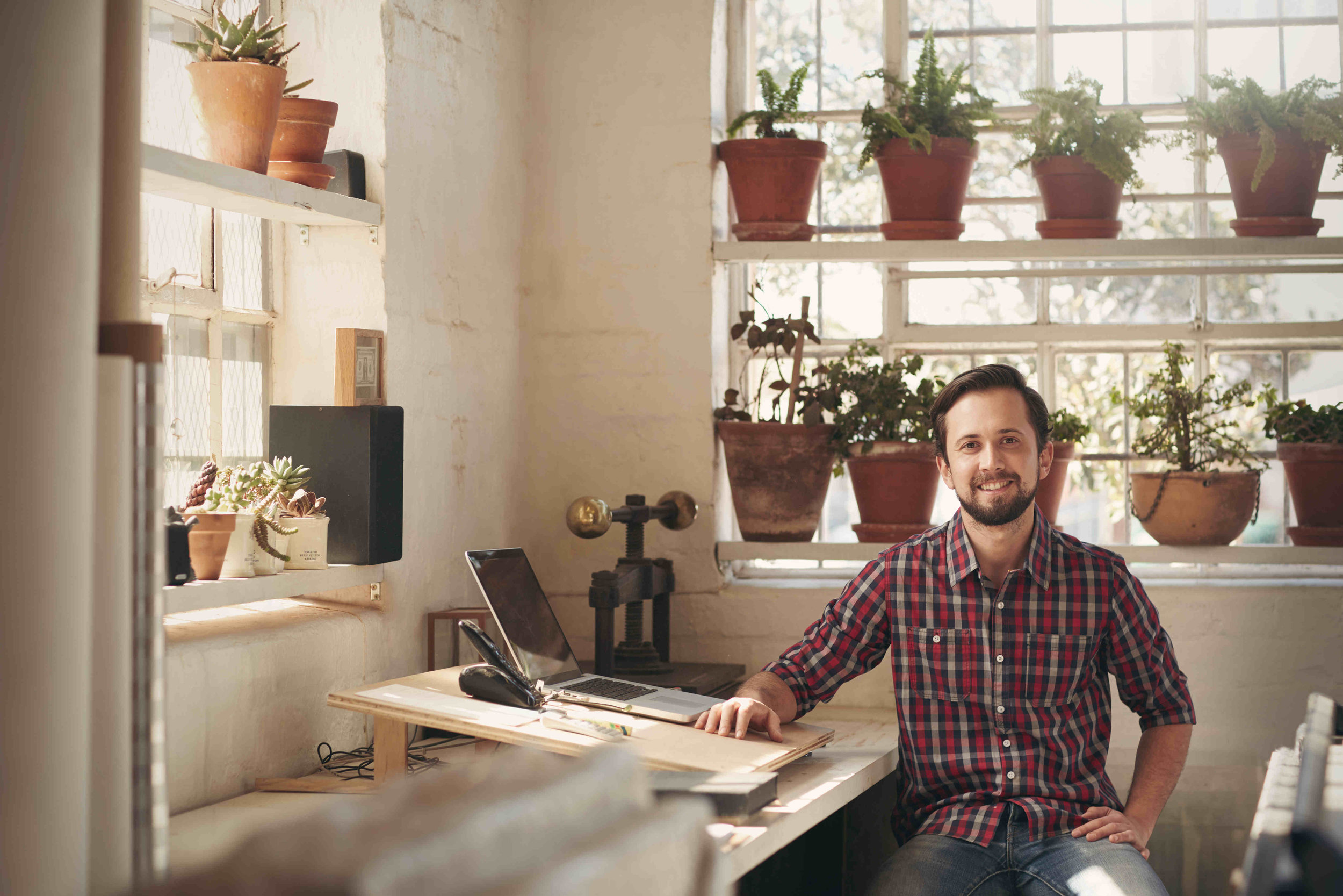 small-business-owner-white-male-office-with-plants.jpg