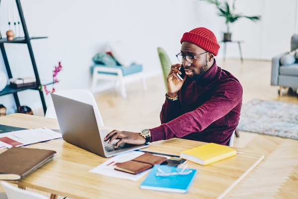 Black man in home office