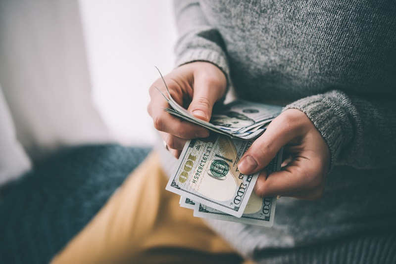 saving-cash-holding-money.jpg
