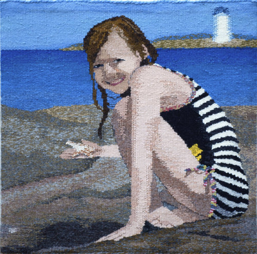 """JULY  This is my grand-daughter. A mountain girl, she can also find wonder in the ocean! I wanted to capture her joy in being new things. This tapestry is woven in wool. It is 18""""x18"""" and mounted on a covered stretcher frame."""