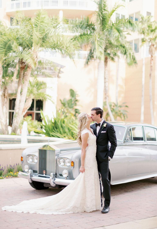 bride-groom-vintage-rolls-royce-limo-ritz-carlton-sarasota-wedding.jpg