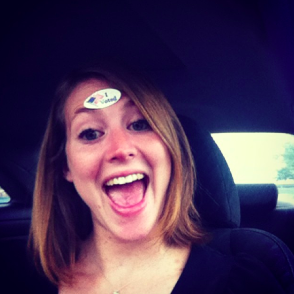 """A Functional Democracy Co-Founder Amy Stansbury proudly sports her """"I Voted Sticker."""""""