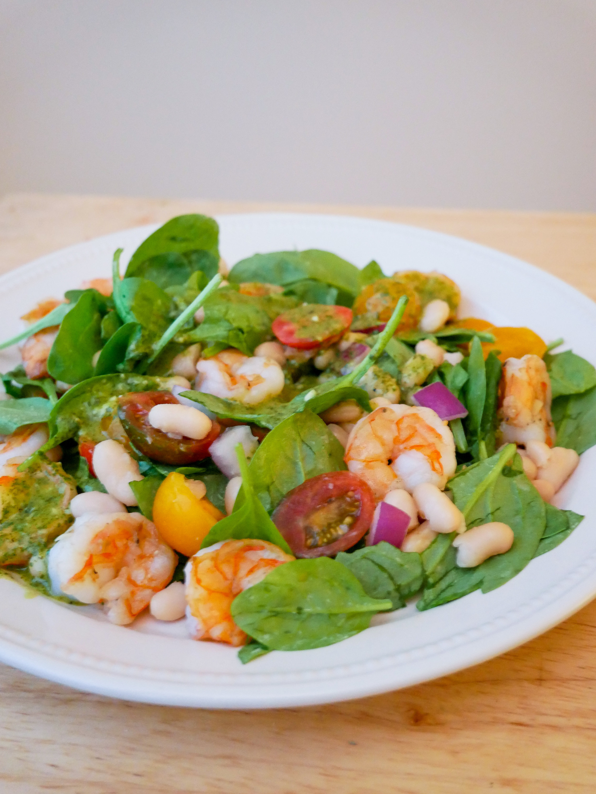 Spinach Salad with shrimp and cannellini beans and cilantro garlic lime dressing