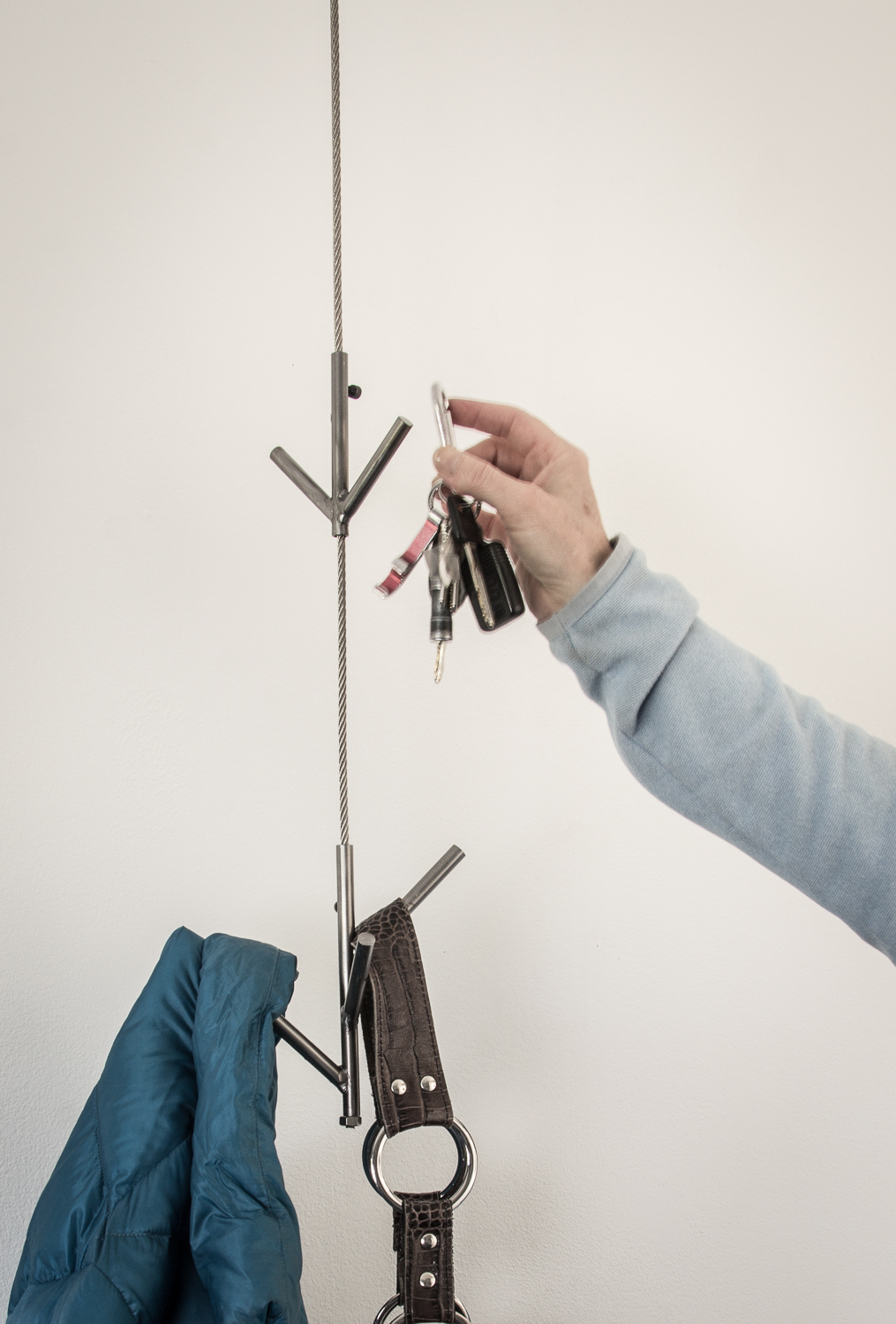 Hooked  Single  cable for your keys, coats and stuff you always misplace.