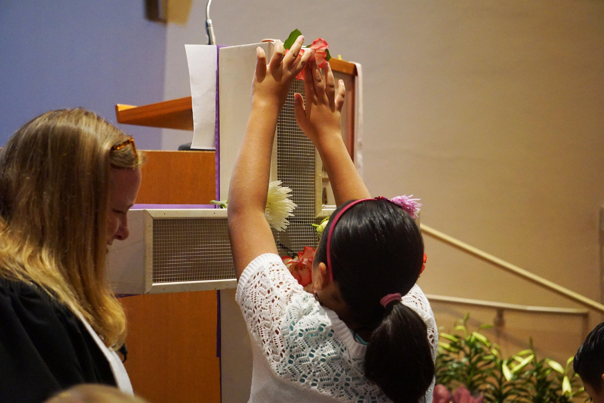 claremont-presbyterian-church-easter-child-flower-cross.jpg
