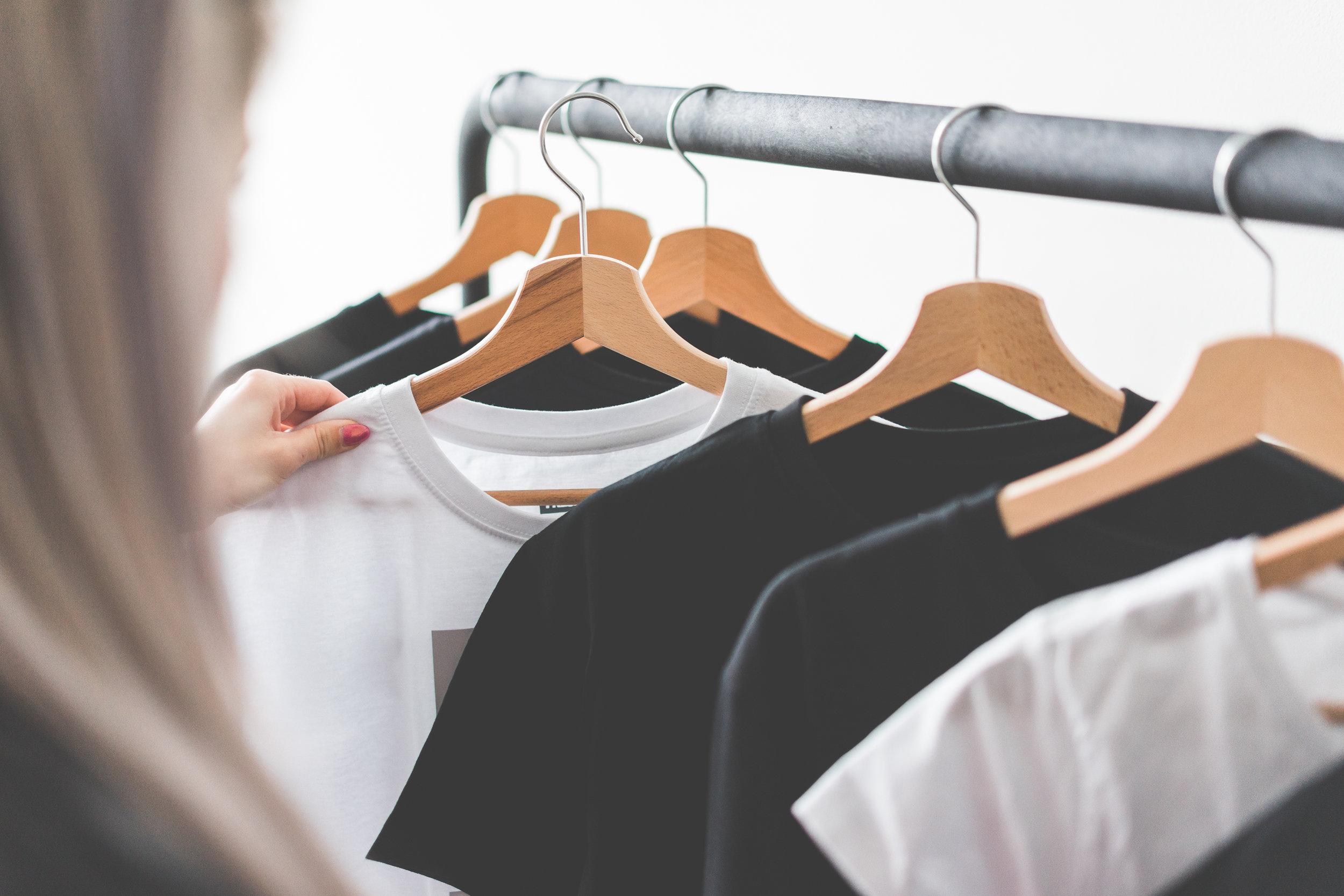 clothing-woman-choosing-t-shirts-during-clothing-shopping-at-apparel-store-picjumbo-com.jpg