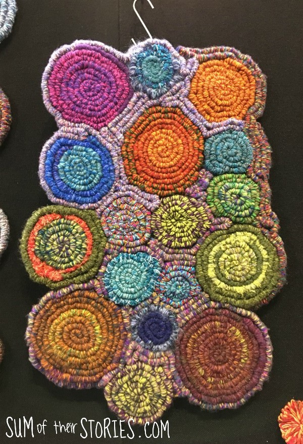 coiled rug made from woven strips