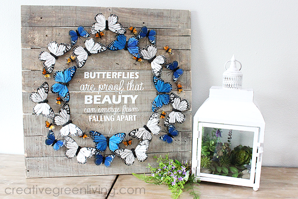 Farmhouse style butterfly decor ideas - indoor wreath on a pallet board with saying 'butterflies are proof that beauty can emerge from falling apart'.png