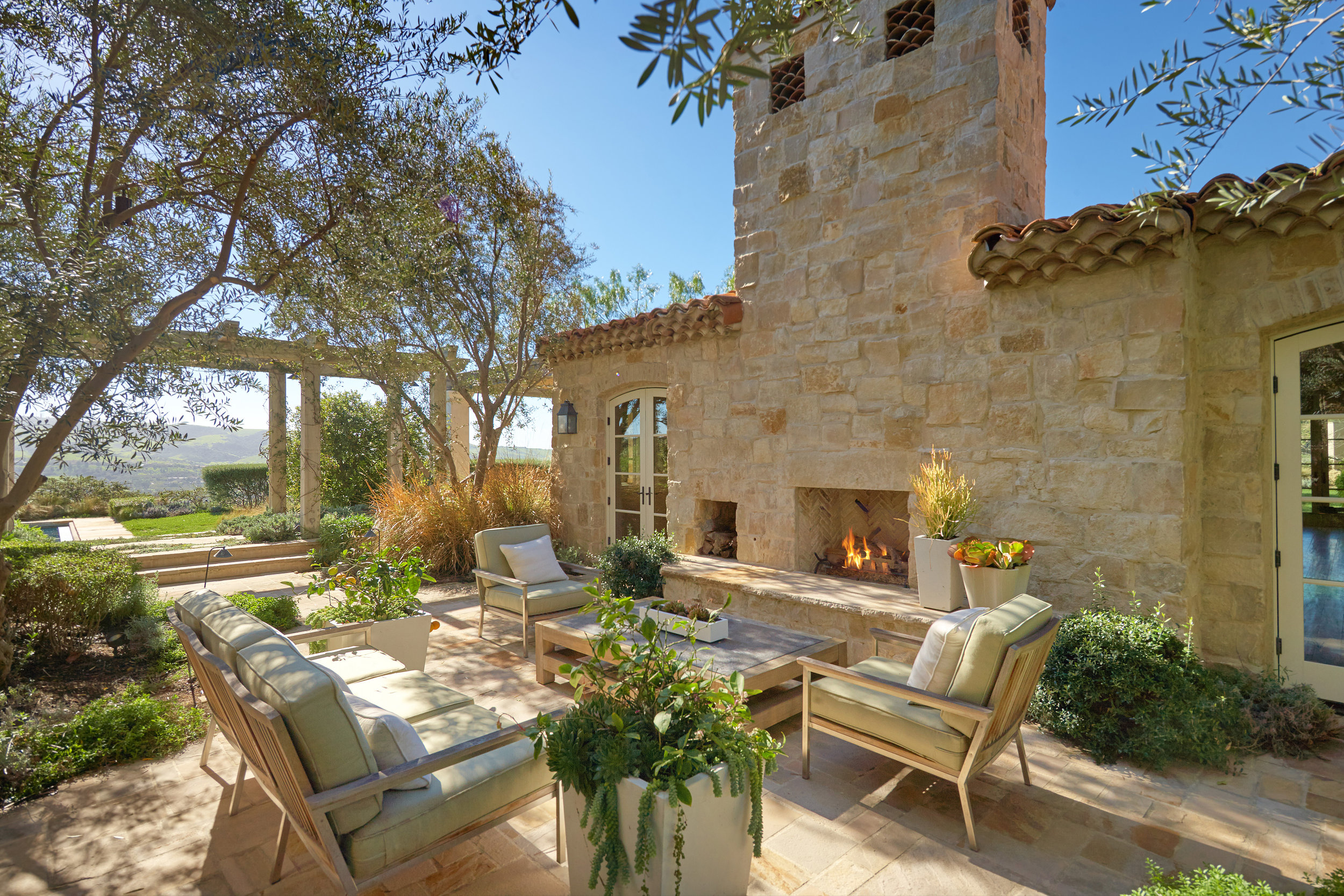 Shady Canyon - Provence Home Outdoor Fireplace by Oatman Architects
