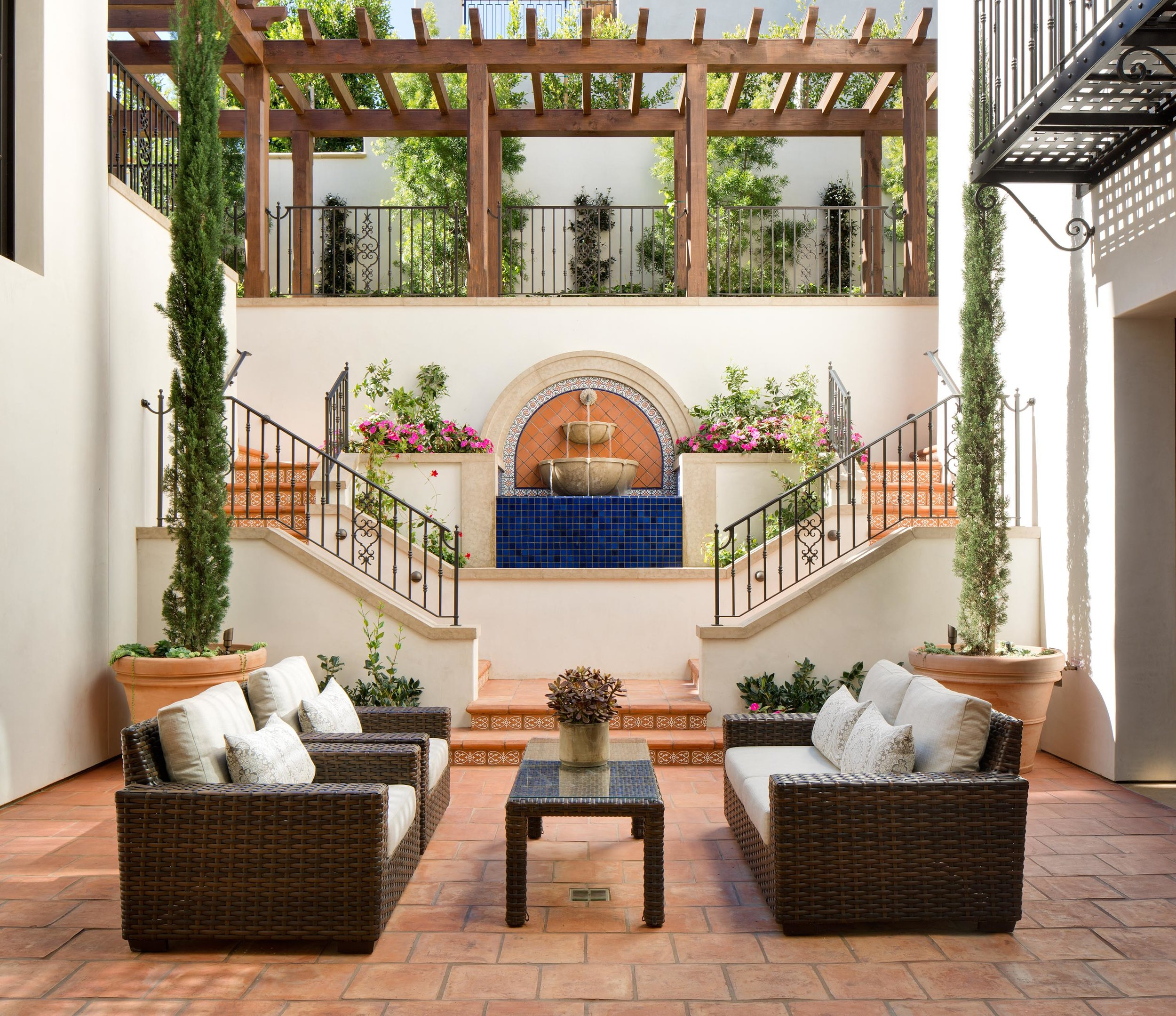 Newport Coast Santa Barbara Style Courtyard by Oatman Architects.jpg