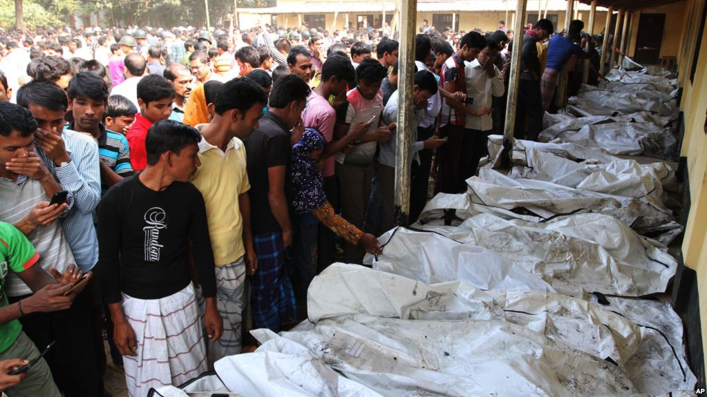 Bangladeshi people identify the bodies of their relatives died in a fire at a garment factory.