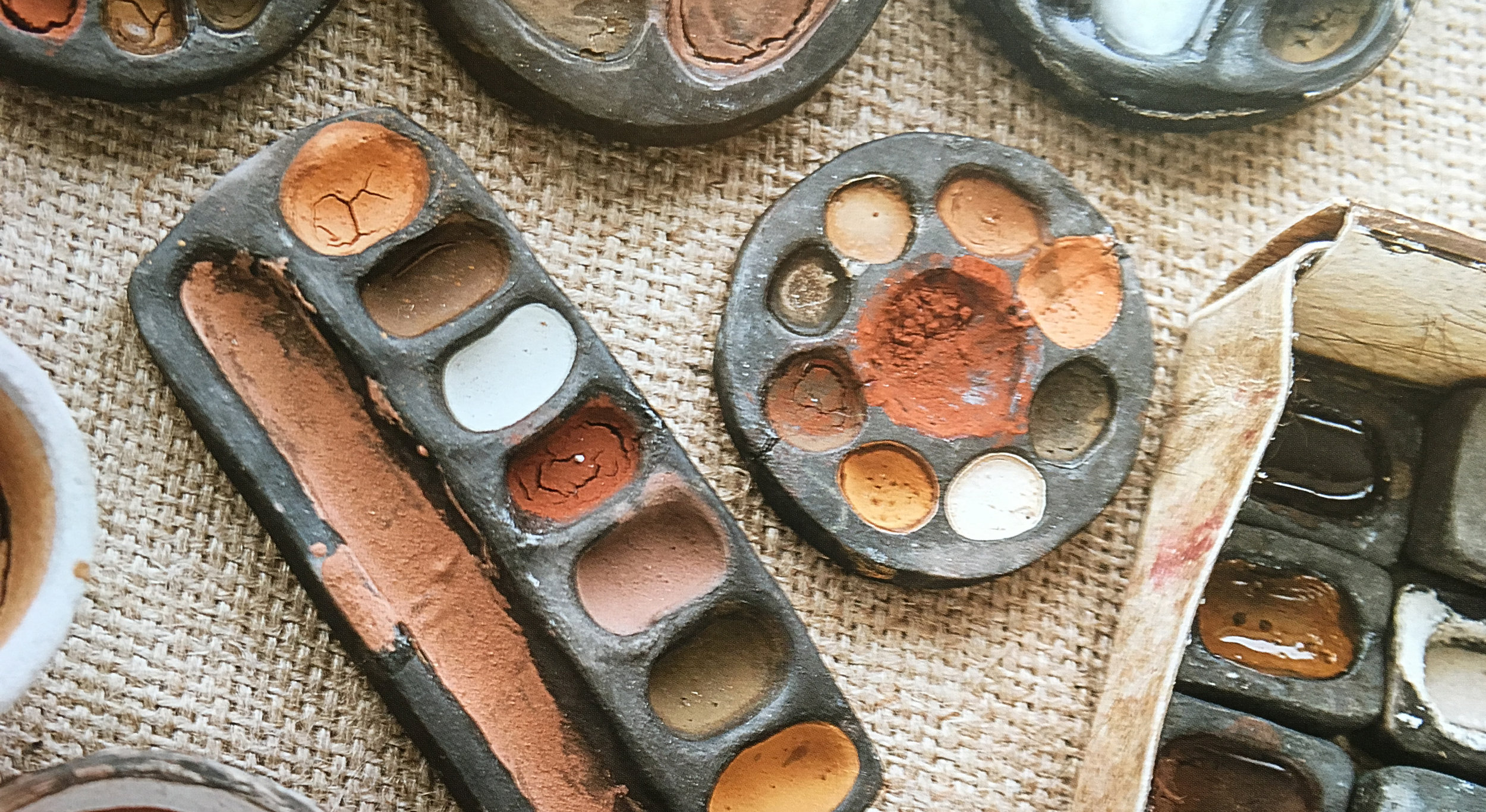 Nick Neddo's palettes: ochres in clay vessels made from foraged wild clay, fired in a fire pit in the Vermont woods. Photo credit: Quarry Books, 2015.
