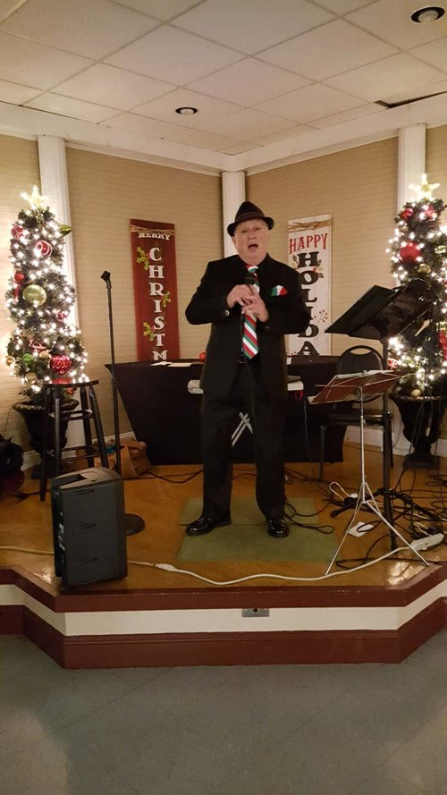 Singer Kenny Marocco entertains members at a La Vigilia Dinner
