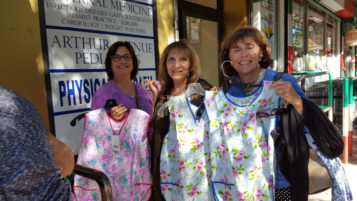 On Arthur Avenue in the Bronx, Grace Toppi, Torie Zaninni and Carol Bissanti purchase aprons reminiscent of those worn by Italian American women