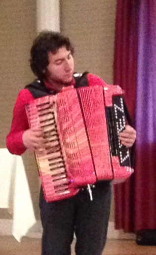 Cory Pesaturo, World Digital Accordion Champion and World Acoustic Accordion Champion, entertains members at a Scholarship Awards Program with a medley of Italian songs