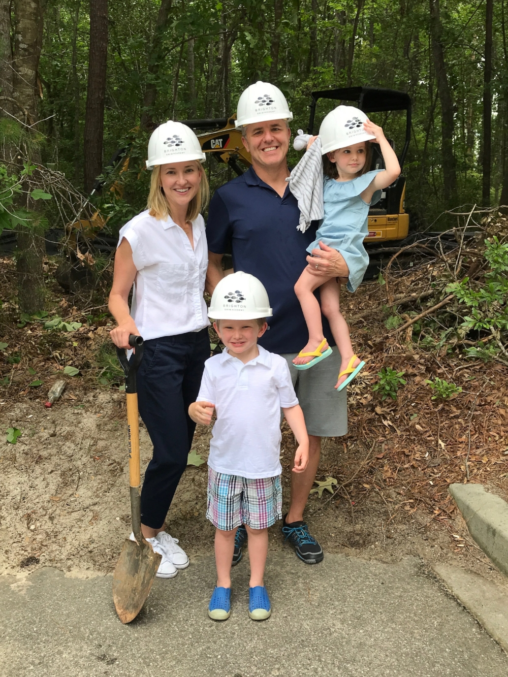May 15, 2018: Family photo before the property is cleared (thank you Faye Bourdon for the hard hats!)
