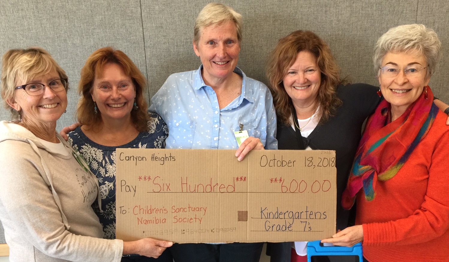 Board Members Holding Fundraiser Cheque