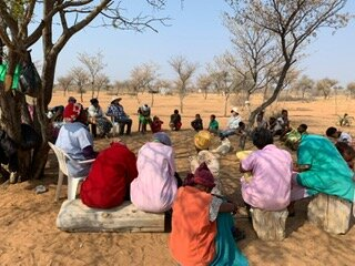 In honour of our visit, Chief Ita invited elders from the community to the Sanctuary Land for daily healing/prayer circles which were held following the meals for the children.