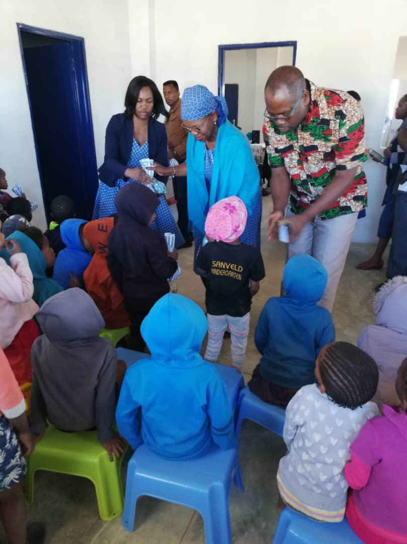 The High Commissioner of Botswana and the Governor of Omaheke presenting children with hampers.