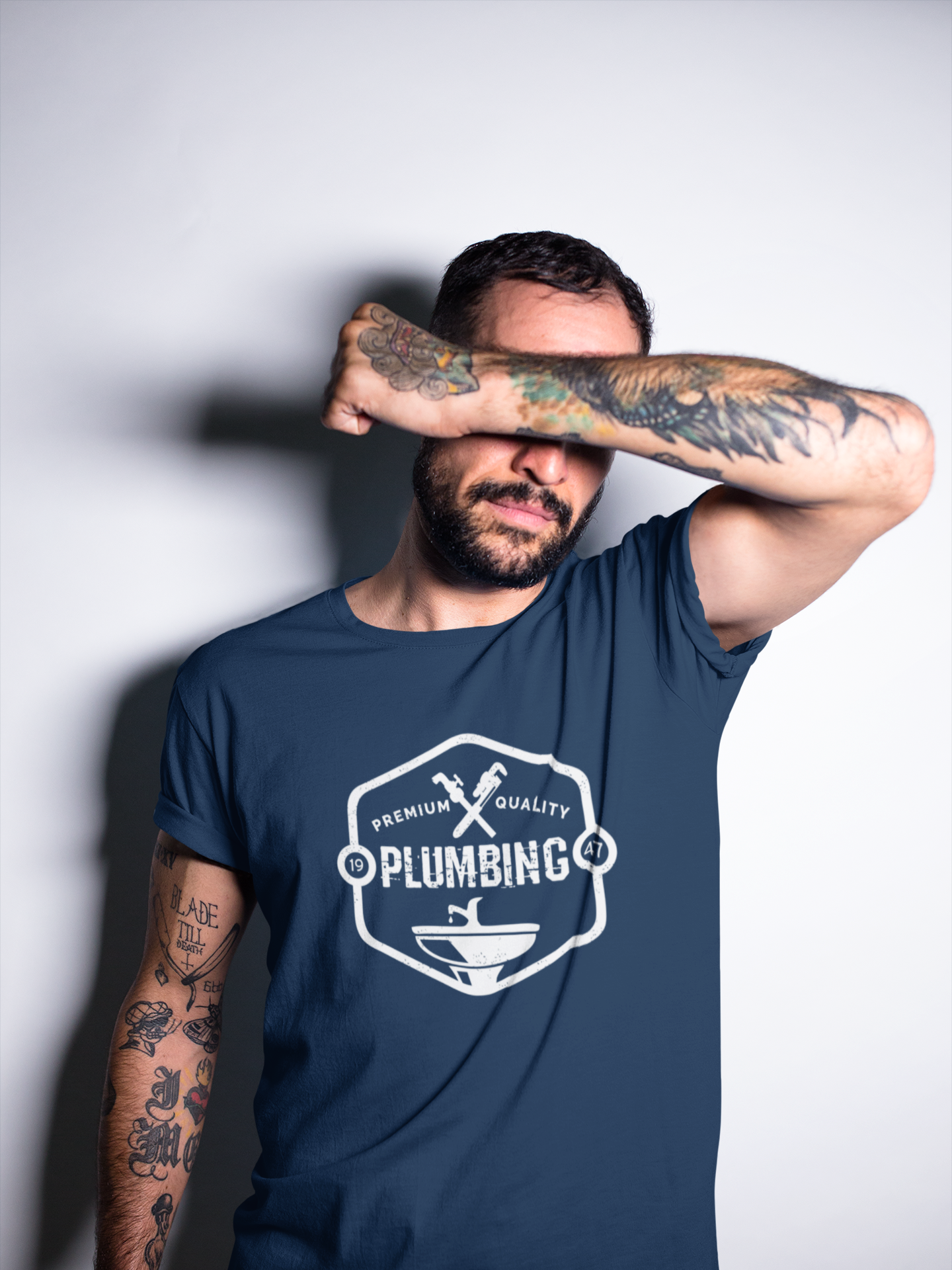 tattooed-man-covering-his-face-while-wearing-a-t-shirt-mockup-a17025.png