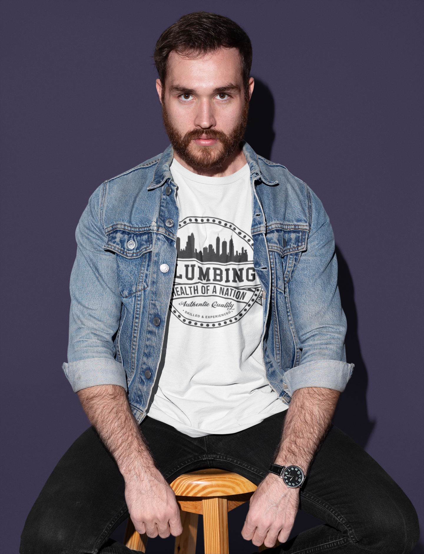 tshirt-mockup-of-a-man-sitting-on-a-wooden-stool-18697.png