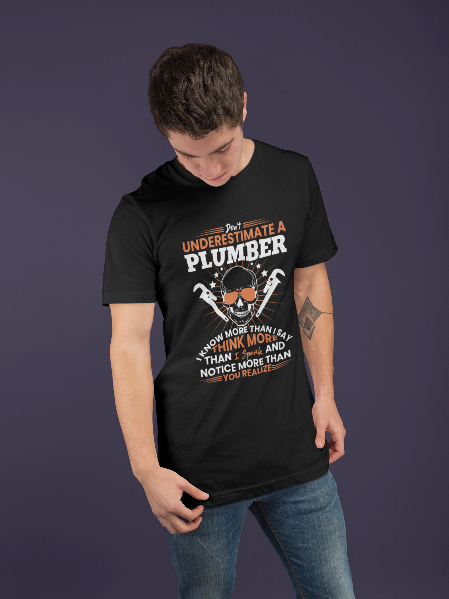 tshirt-mockup-of-a-man-with-a-tattoo-at-a-studio-25287.png