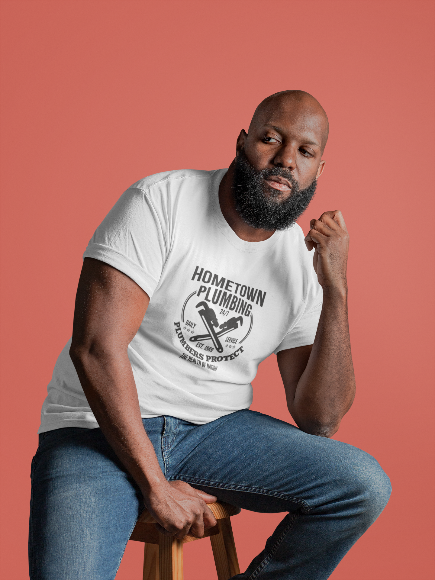 t-shirt-mockup-of-a-thoughtful-man-sitting-on-a-chair-21535.png