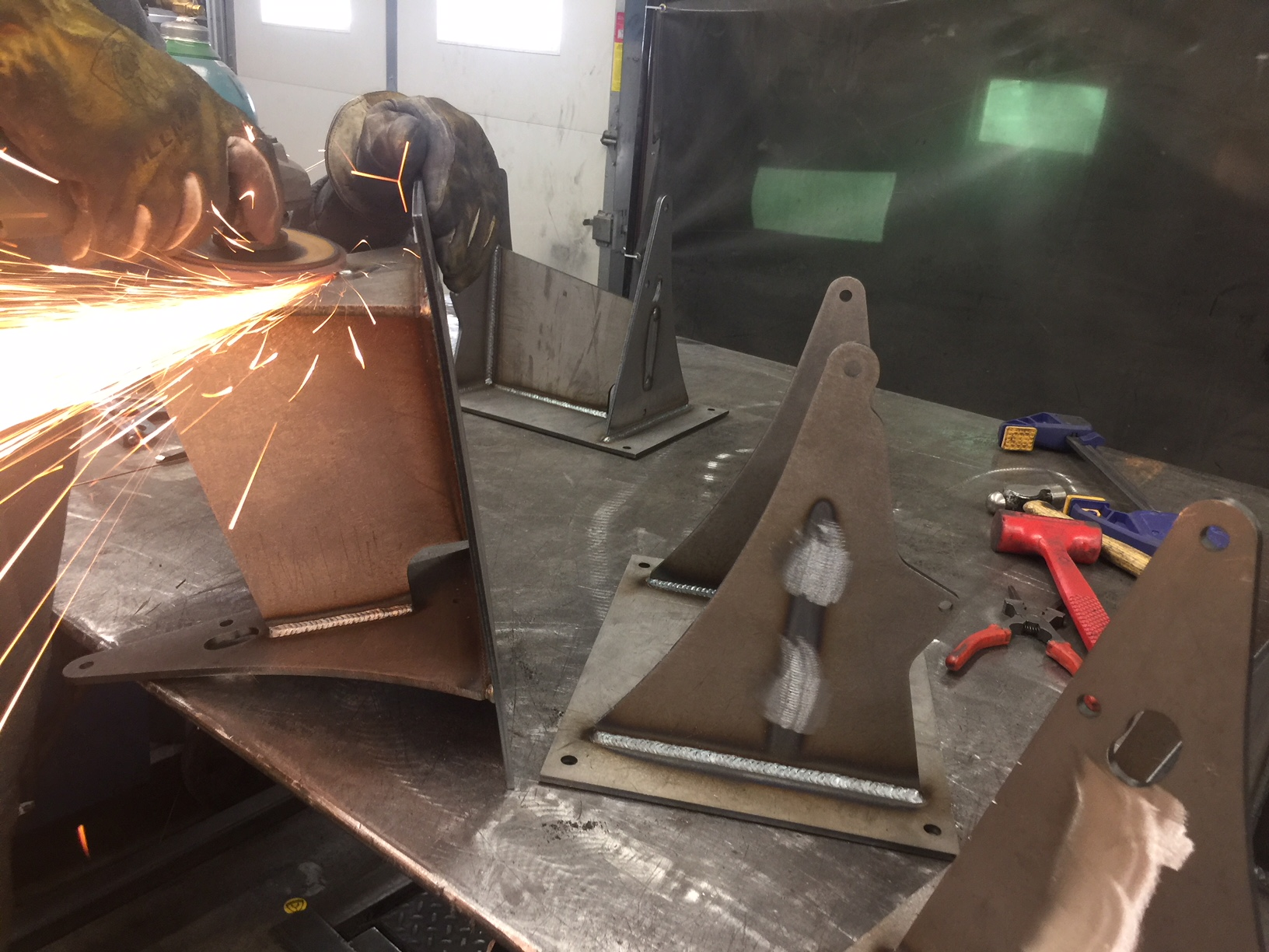 Post weld cleanup on the base weldment. These guys really know how to lay down some nice welds.