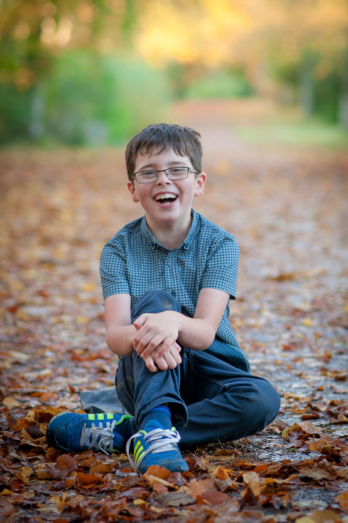 Boy laughing, autumn. Dundee family photography.