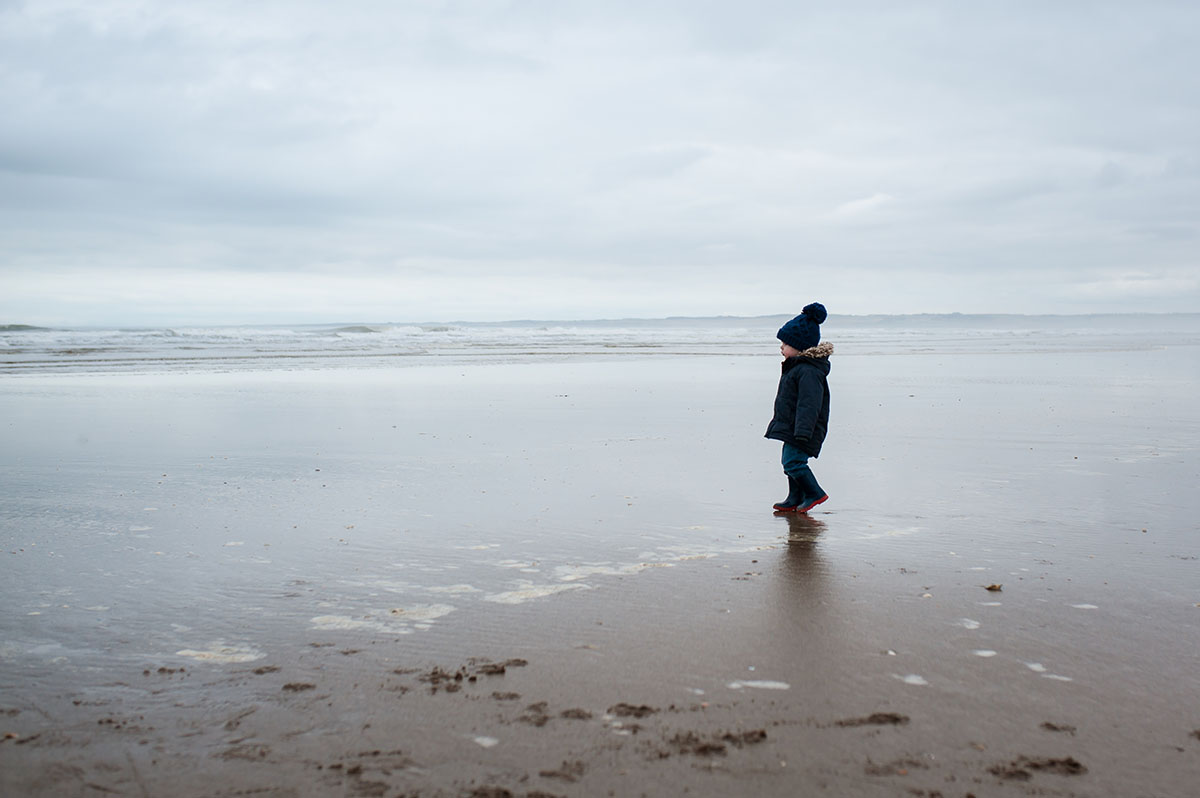 Little boy looking out to sea. Dundee family photography.