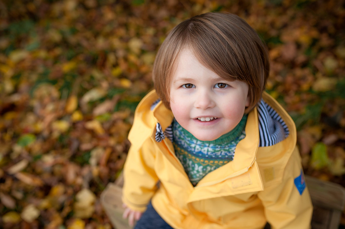 Little boy in yellow coat. Family photography Dundee.