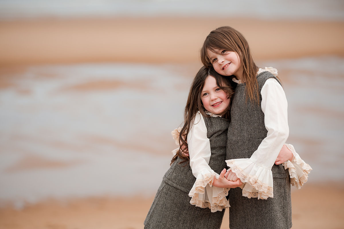 Sisters hugging on Angus beach.jpg