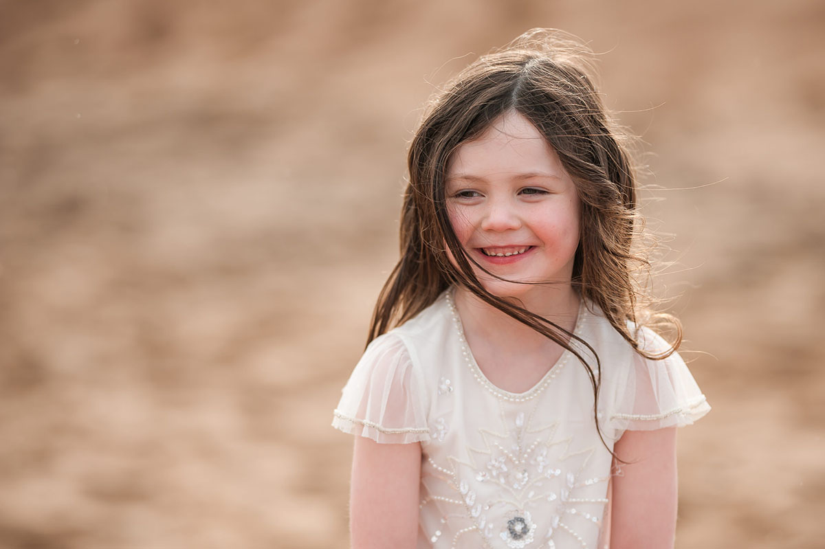 Little girl giggling in the sunset on Angus beach.jpg