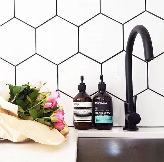 black and white - the most classic combo. why would grout be any exception? also please note the hex and matte black fixture - v haute.