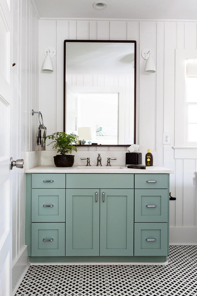 a great example of a semi-custom vanity; add a filler strip to the wall and add a toe kick for a fully custom, built-in look.