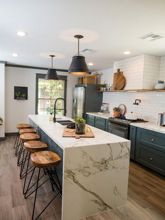 waterfall countertops create a beautiful kitchen statement and contrast beautifully with bold cabinets.